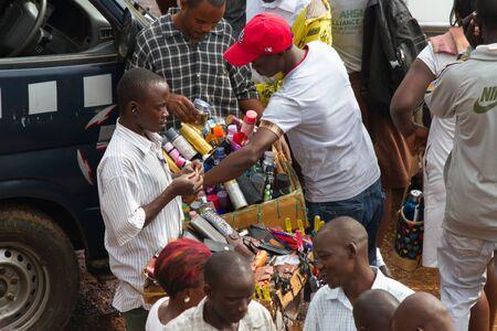 KAMPALA, UGANDA - OCTOBER 03, 2012.  A man sells wallets to passengers at the taxi park in Kampala, Uganda on October 03,2012.