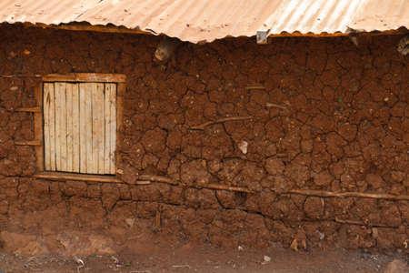 A mud hut home with a window inside the Kibera slum of Nairobi, Kenya