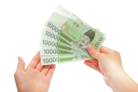 Money on hand with white background Stock Photo - 10661413