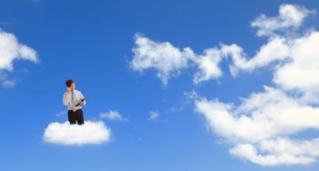 raises: Cloud computing concept. Businessman holding a laptop