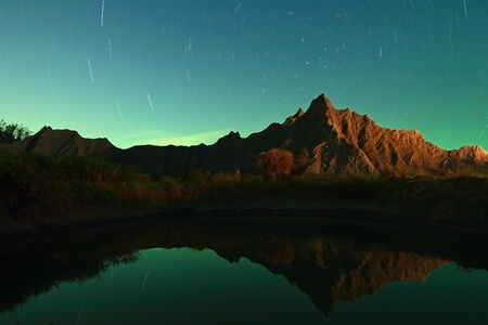 star night with mountain reflection photo