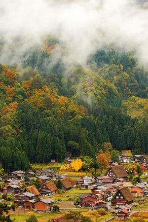 beautiful country in japan with mist and beautiful mountain photo