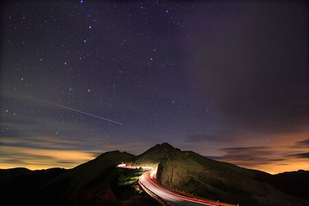 earth road: Amazing starry night accompany with a metor