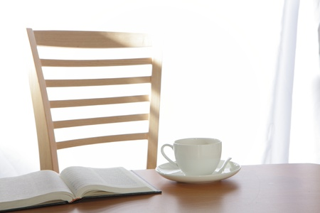 dinning table: coffee Cup book and plant on wooden table