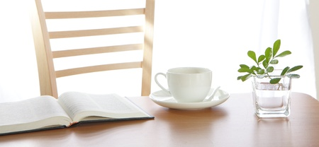 coffee Cup book and plant on wooden table  photo