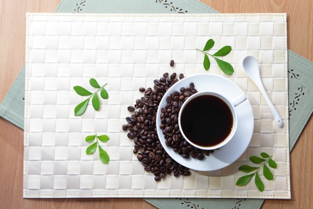 teatime: Coffee bean and hot coffee with green leaf  Stock Photo