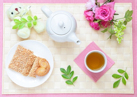 refined and leisurely tea time with cookie, cute bear and beautiful flowers  photo