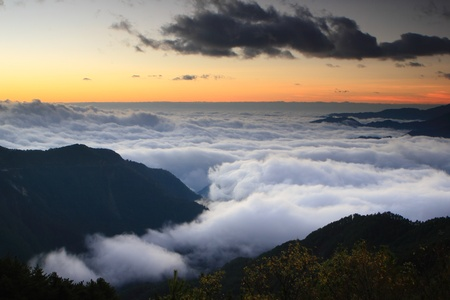 Amazing sea of clouds with sunset photo