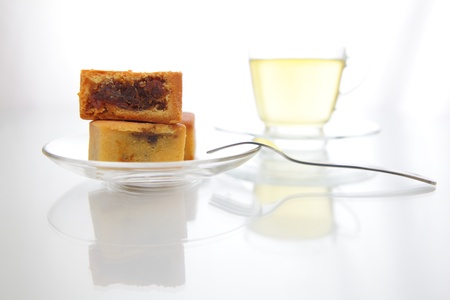 delicious pineapple cake with green tea and fork photo