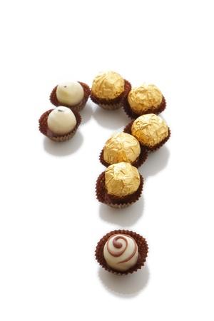cafe bombon: chocolate con signo de interrogación Foto de archivo