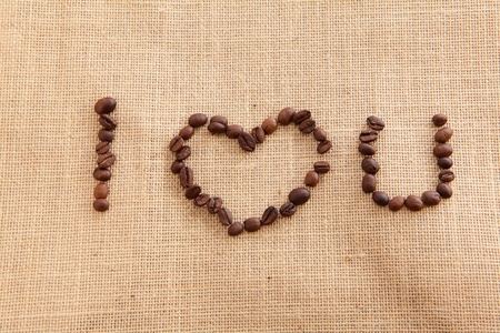 burlap background: Coffee beans on linen background