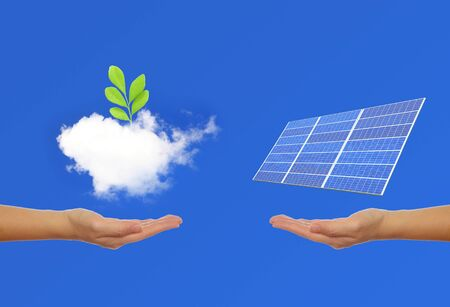 solar panel with hand and green tree photo