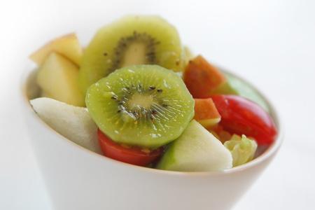 fresh fruit salad with kiwi,tomato,apple,etc. photo