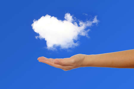 hand holding a cloud,concept of cloud computing or eco issue Stock Photo - 10995086