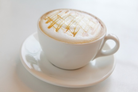 a cup of coffee with beautiful caramel photo