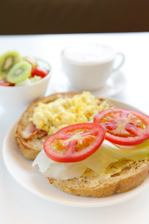 delicious breakfast with coffee and fruit salad photo