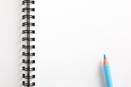 clean cut: notebook and blue pencil on white background Stock Photo