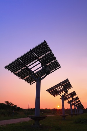 photocell: silhouette of solar panel with beautiful sunset