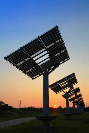 solar collector: silhouette of solar panel with beautiful sunset