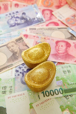 nt: Golden coins and Background of asian currency (include Korean Won, Taiwan dollar, Chinese Money yuan , Hong Kong Dollar, japanese Yen) Stock Photo