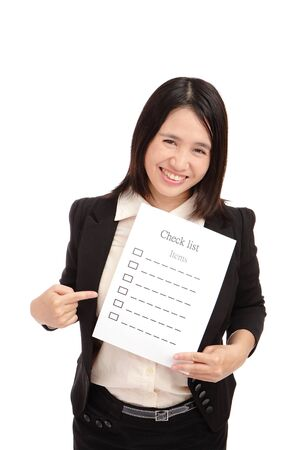 Business woman smilingly take check item paper  photo