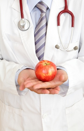 health care decisions: doctor holding a apple