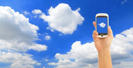 businessman phone: transmit data to the cloud, hand with mobile phone Stock Photo