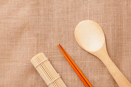 chinese wood tableware on linen tablecloth texture photo