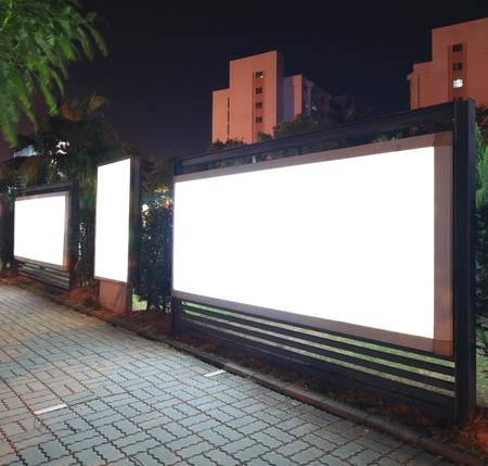 Blank billboard at night photo