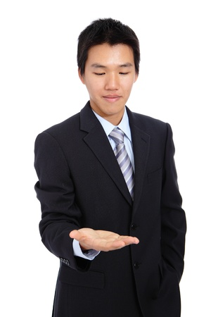 young business man holding hand presenting a product. isolate on white background photo