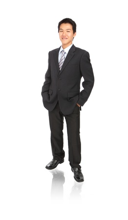 businessman standing: Business young man with confident smile