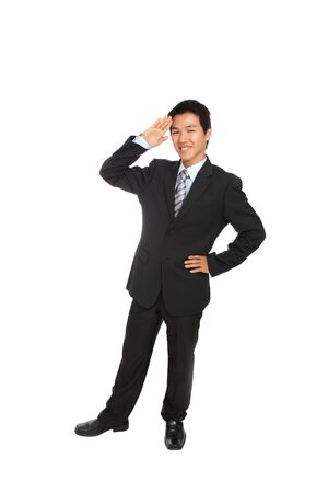Salute: Yes Sir! Business man gives salute isolated on white background