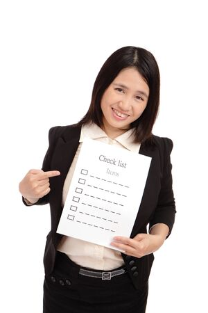 Business woman smilingly take check item paper Stock Photo - 11189164