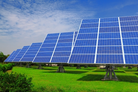 solar equipment: Solar Panel with green grass and beautiful blue sky Stock Photo