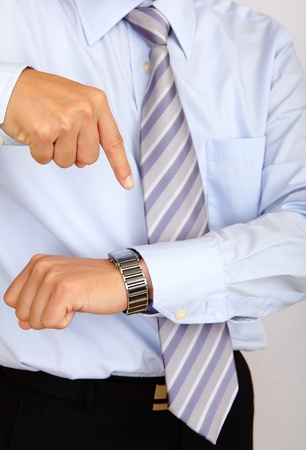 looking at watch: time is up, business man hand finger and watch Stock Photo