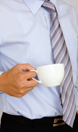 business man take a cup of coffee photo