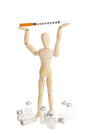 injector: Wooden figure holding medicine injector