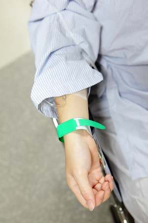 Patient hand before surgery in an operation room Stock Photo - 11189205