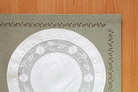 Beautiful Green tablecloth and flower lace on wood table - tablecloth texture photo