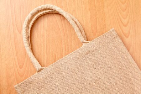 fabric bag: linen bag with wood background Stock Photo