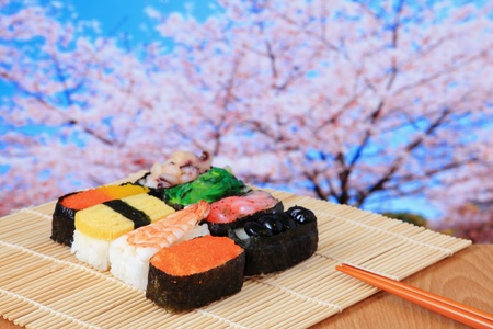 tasty japan sushi with pink cherry blossoms tree photo