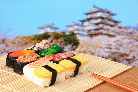 tasty japan sushi with pink cherry blossoms tree and Japanese castle