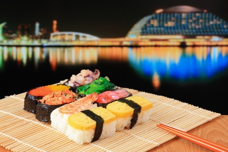 delicious Japanese sushi mix with japan night scenes photo