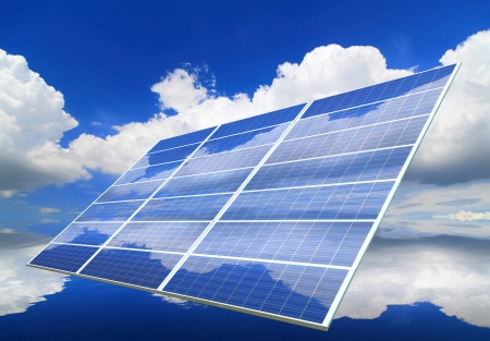 Solar Panel with reflection of blue sky and white cloud  photo