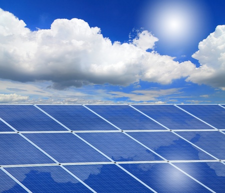 Solar Panel with reflection of blue sky ,white cloud and sun Stock Photo - 11241220