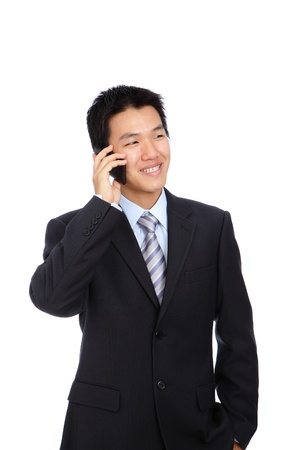 Young Business Man happy Speaking mobile phone, isolated on white background photo