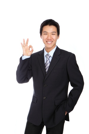 okay sign: Young Business Man with OK hand gesture , isolated on white background Stock Photo