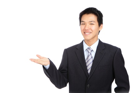 Young business man smile introduce with hand gesture Stock Photo - 11241154