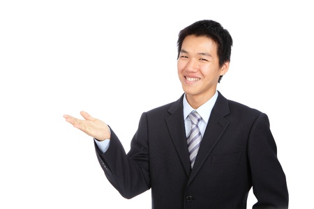 Young business man smile introduce with hand gesture photo