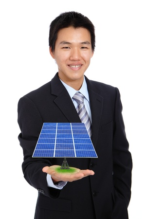 solar equipment: young business man holding a solar panel and power